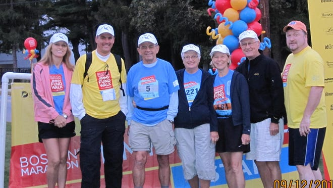 """Jeanette Voss, and her team, The Paper Cranes, have received a """"$500,000+ Team Lifetime Achievement"""" award for their efforts Boston Marathon Jimmy Fund Walk."""