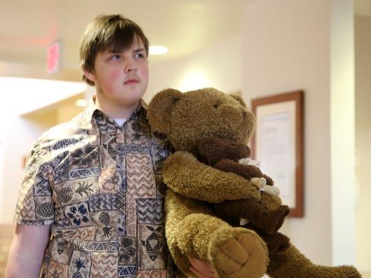 Piedra Vista High School senior Jared Young holds a teddy bear Wednesday that was donated to the pediatric unit at San Juan Regional Medical Center. Young organized and participated in the drive as part of a National Honor Society community service requirement.