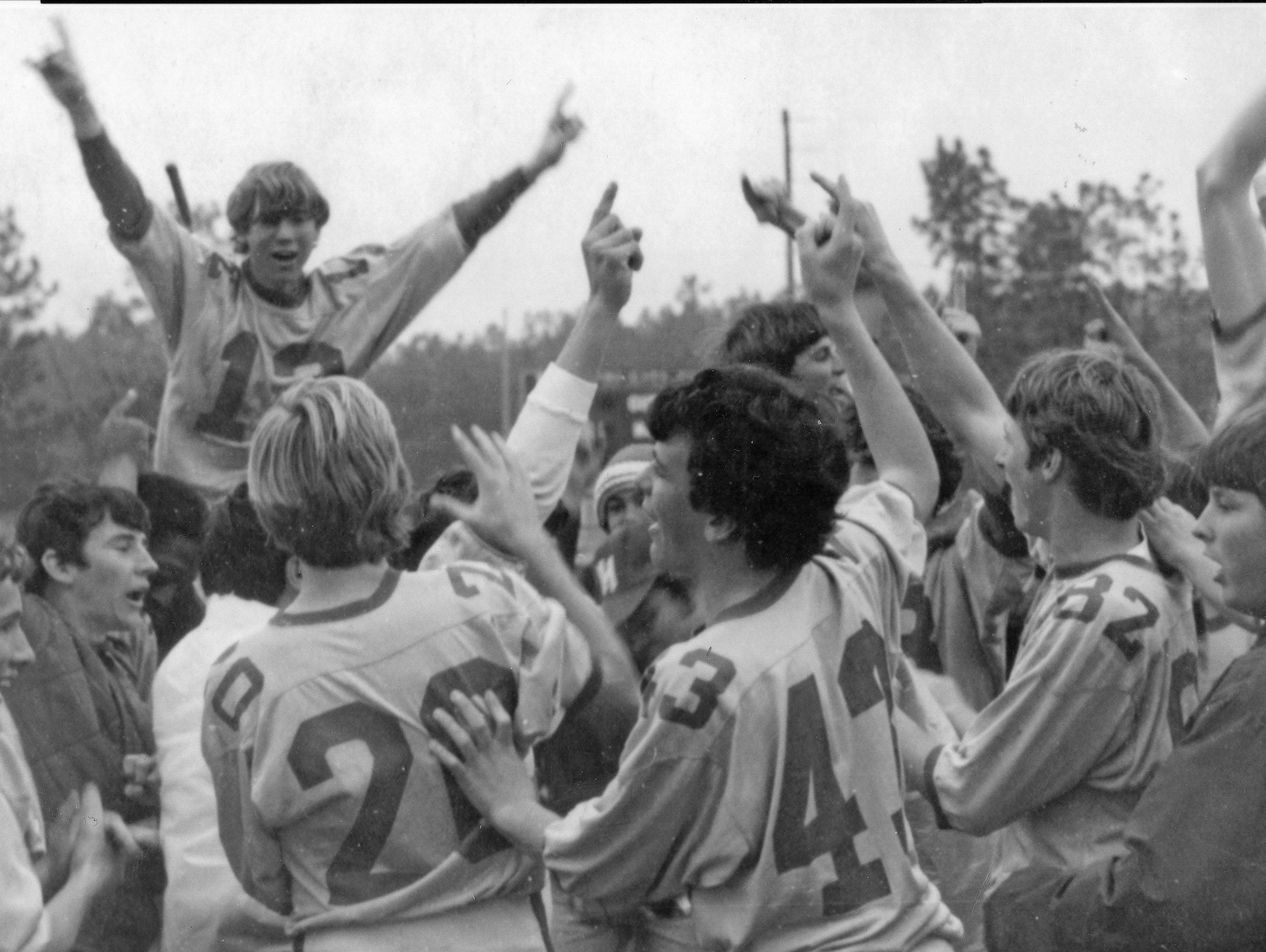 The Wade Hampton soccer team celebrates after winning the 1974 state championship.