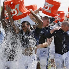Tennessee Titans players take part in the ALS Ice Bucket Challenge after NFL football practice in Nashville.