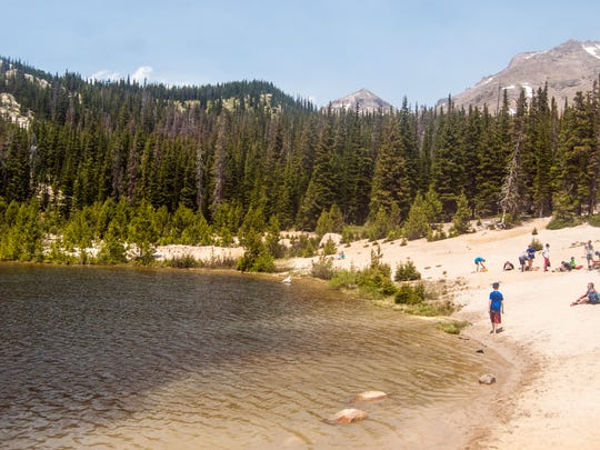 Sandbeach Lake in Rocky Mountain National Park features a sandy beach around most of the alpine lake at 10,283 feet.