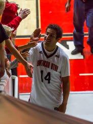 Southern Utah guard James McGee (14) high fives fans
