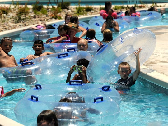 Kids float around the lazy river on Thursday, June
