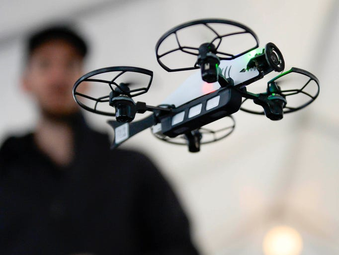 Drone pilot Colby Curtola flies a small consumer drone