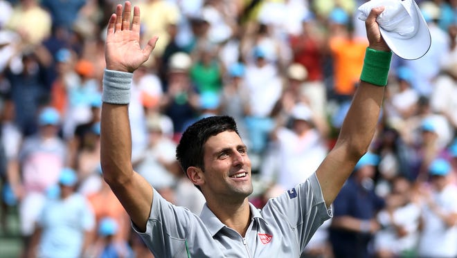 Novak Djokovic of Serbia waves after defeating Rafael Nadal, of Spain, 6-3, 6-3  at the Sony Open men's final match on Sunday