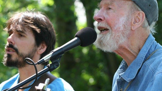 Guitarist Spook Handy (left) performs with folk singer Pete Seeger. Seeger died in 2014.