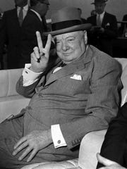 British Prime Minister Winston Churchill responds with the V for victory sign that became his trademark during World War II as spectators cheer his arrival in Washington, D.C., in June 1954.