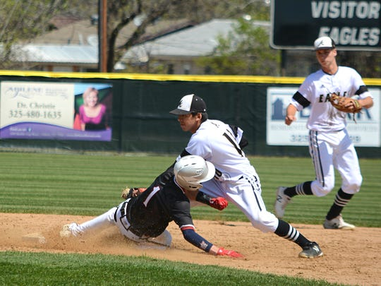 Abilene High second baseman Marcus Romero tags out Keller Central's Anthony Soria at second during the Eagles' 4-3 win Friday at Blackburn Field.