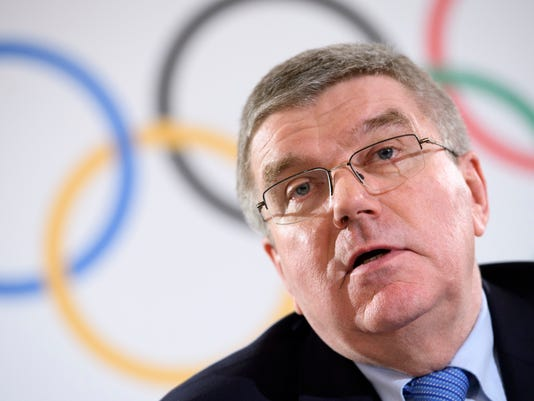 FILE  - In this Thursday, Dec. 8, 2016 file photo, International Olympic Committee (IOC) president Thomas Bach, from Germany speaks during a press conference after the executive board meeting of the International Olympic Committee, in Lausanne, Switzerland. Bach welcomes talk that two Summer Games hosts could be picked in September.  (Laurent Gillieron/Keystone via AP, File)