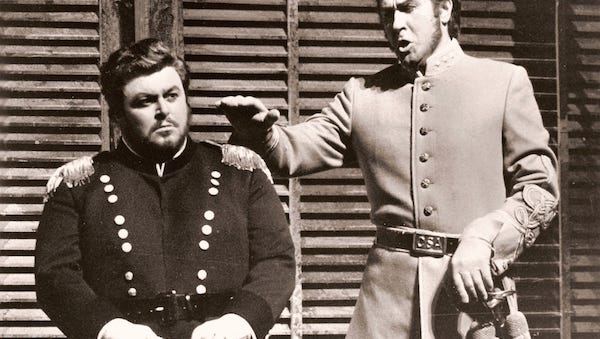 "Sherrill Milnes, as Renato in ""Un Ballo inMaschera,"" grilling a reluctant Luciano Pavarotti as Riccardo, in 1974 at the Metropolitan Opera."