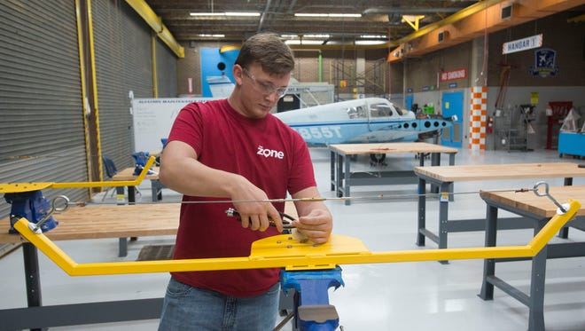Student Jesse Marti learns aviation maintenance technology at George Stone. Marti began studying aviation repair and maintenance while as a student at Washington High School.
