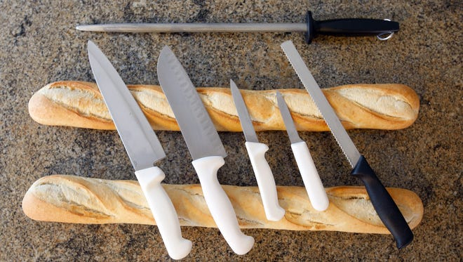 A basic set of knives could include a chef's knife; a santuko, which has a straighter edge than a chef's knife; a couple of paring knives; a serrated knife; and a sharpening steel.
