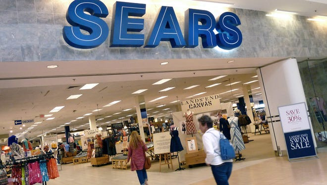 Shoppers walk into Sears in Peabody, Mass. in 2012.