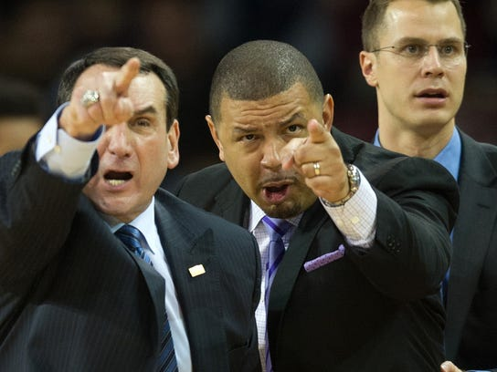 "FILE - In this Jan. 2, 2016, file photo, Duke head coach Mike Krzyzewski, left, and associate head coach Jeff Capel gesture during the first half of an NCAA college basketball game against Boston College, in Boston. At far right is assistant coach Jon Scheyer. Simply mentioning ""back surgery"" and ""Mike Kryzyzewski"" in the same sentence is enough to give even the most dedicated Duke fan _ or hater _ a flashback to 1994-95. With Kryzyzewski sidelined for the final 19 games of that year, those Blue Devils finished 13-18 and became the only Duke team since 1983 to miss the NCAA Tournament. (AP Photo/Gretchen Ertl, File)"