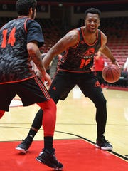 Southern Utah University forward Jamal Aytes tries