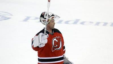 New Jersey Devils goalie Martin Brodeur waves to the crowd after a game Sunday against the Boston Bruins in Newark, N.J. The Devils won 3-2.