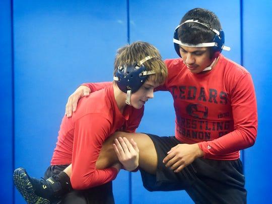 Lebanon High School wrestler Jose Barrios, on the right,