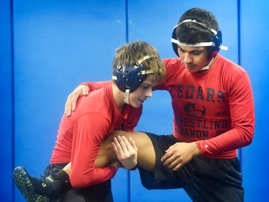 Lebanon High School wrestler Jose Barrios, on the right,