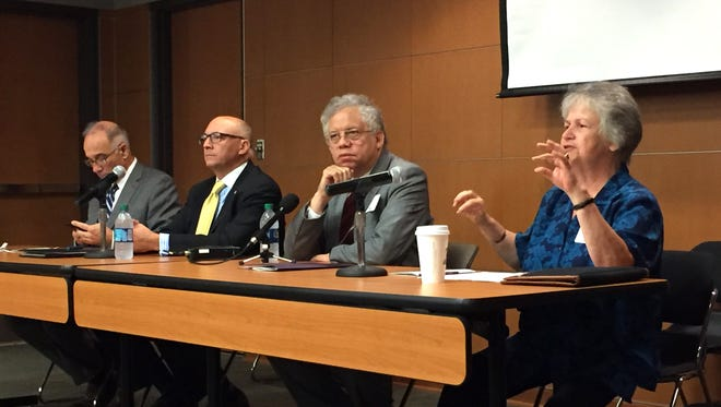 From left to right, panelists Thomas Miller of Southern University, Matthew Lee of LSU, Matthew Ware of Grambling State University and Mary Jarzabek of LSU-Shreveport engage in a discussion on historically black colleges and universities during a symposium on race relations at LSU Tuesday.