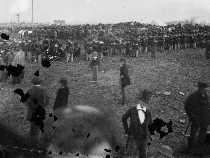 """A crowd assembles Nov. 19, 1863, for President Abraham Lincoln's address at the dedication of a portion of the battlefield at Gettysburg, Pa., as a national cemetery. """"The battlefield, on that somber autumn day, was enveloped in gloom,"""" Joseph Ignatius Gilbert, a freelancer for the Associated Press, wrote. """"Nature seemed to veil her face in sorrow for the awful tragedy enacted there."""""""