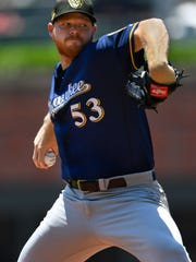 Milwaukee Brewers' Brandon Woodruff pitches during the first inning of a baseball game against the Atlanta Braves, Sunday, May 19, 2019, in Atlanta. (AP Photo/John Amis)