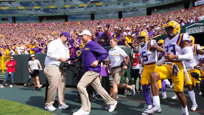 Head coach Les Miles lead the LSU Tigers onto the field prior to the game against the Wisconsin Badgers at Lambeau Field.  LSU lost 16-14.