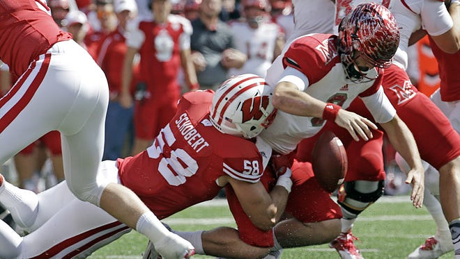Miami of Ohio quarterback Drew Kummer fumbles the ball as he is sacked by Wisconsin's Joe Schobert (58) during the second half on Saturday in Madison.