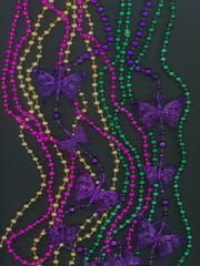 Supplies for making your own Mardi Gras beads can be found at many local craft stores.