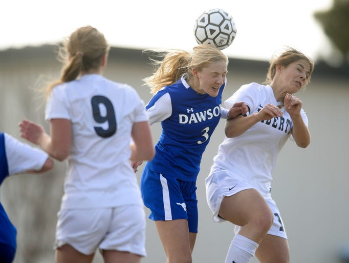 From left, Alexander Dawson's Morgan Powers and Liberty Common's Olivia Bachelet go up for a header during the first half of their game Monday, April 7, 2014. Liberty Common won 7-0.