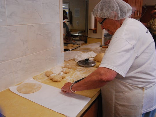 Maggie Peacock rolls out the dough for pasties at First Congregational Church in New Baltimore.