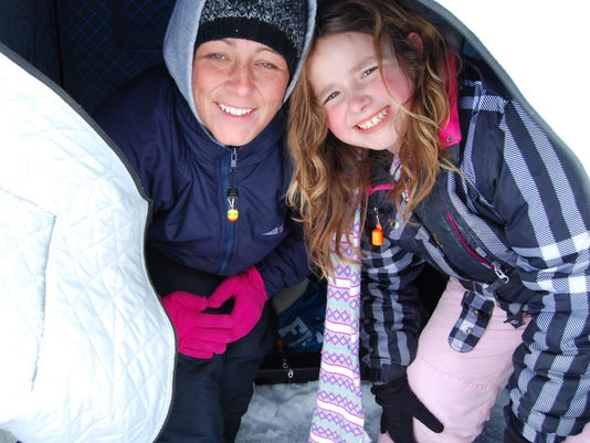 Kids and parents bond by ice fishing