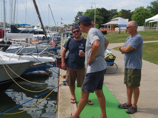 Paul Bassett, left, Dave Feldpaush and Stan Turkiewicz helped bring the Courage across Lake St. Clair and the St. Clair River to Port Huron for the Mackinac race.