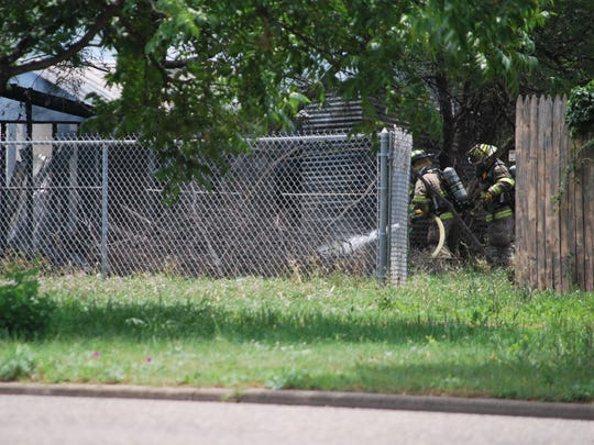 Firefighters work to put out a structure fire at the
