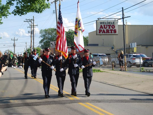 The Delhi Township Fire Department Honor Guard leads