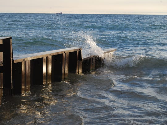 Waves smash into a seawall in Fort Gratiot. A small