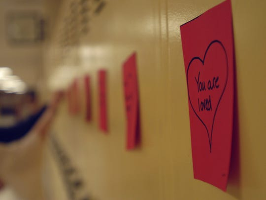 Megan Hicks, 14, and her friends, taped valentines to student lockers at Port Huron Northern High School in response to Rachel's Challenge.