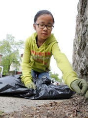 Katie Hall, then 10, worked along Chase Avenue as part of the Great American Cleanup in 2013.