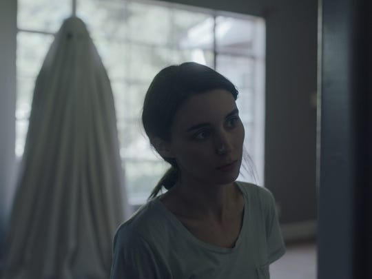 """M (Rooney Mara) is haunted by her lover's ghost (Casey Affleck) in the eerie emotional drama """"A Ghost Story."""""""