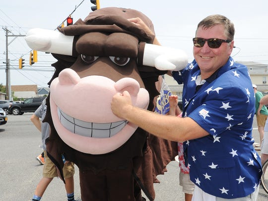 "Steve ""Monty"" Montgomery, co-owner of The Starboard, has fun with the bull during last year's Running of the Bull."