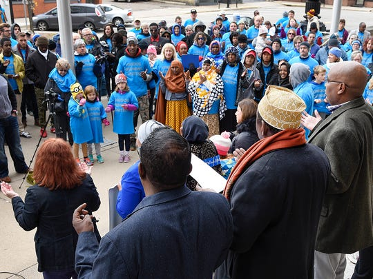 English-, Spanish- and Somali-speaking people gathered to pray during a unity walk Saturday in St. Cloud.