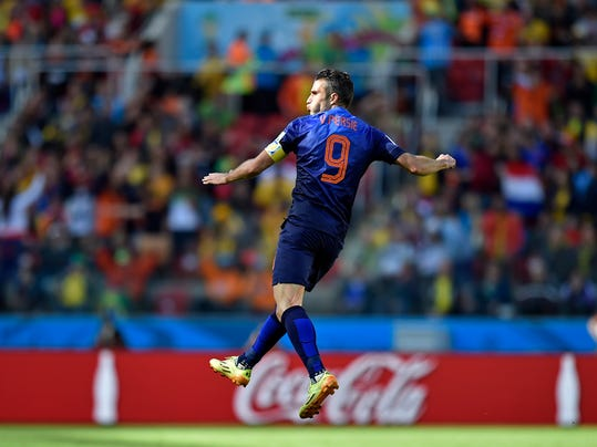 Netherlands' Robin van Persie celebrates after scoring his side's second goal during the group B World Cup soccer match between Australia and the Netherlands at the Estadio Beira-Rio in Porto Alegre, Brazil, Wednesday, June 18, 2014.   (AP Photo/Martin Meissner)
