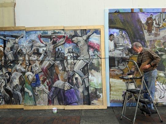 Bob Adams paints murals along Dexter Avenue in 2010.