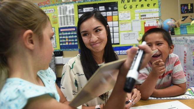 First grade class Marisa Nabong, middle, helps her students at Natchez Elementary School in Wadsworth on Sept. 6, 2017. Jason Bean/Reno Gazette-Journal- USA TODAY NETWORK