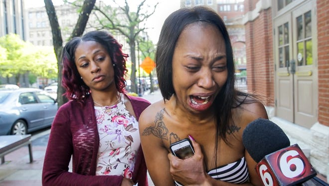 From left,  Angela and Erica Bailey, daughters of Aaron Bailey, react to the Civilian Police Merit Board decision outside of the City-County Building in Indianapolis on Thursday, May 10, 2018. The Civilian Police Merit Board found that the officers who fatally shot Aaron Bailey did not violate IMPD policy. Aaron Bailey, 45, was unarmed when he was fatally shot on June 29 after a traffic stop, short pursuit and minor crash.