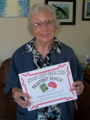 Doris Bonnewell receives the Stewart County Senior Citizen Fruitiest Senior Award for the entering the largest tomato in the 2015 Largest Tomato Contest at the Center.
