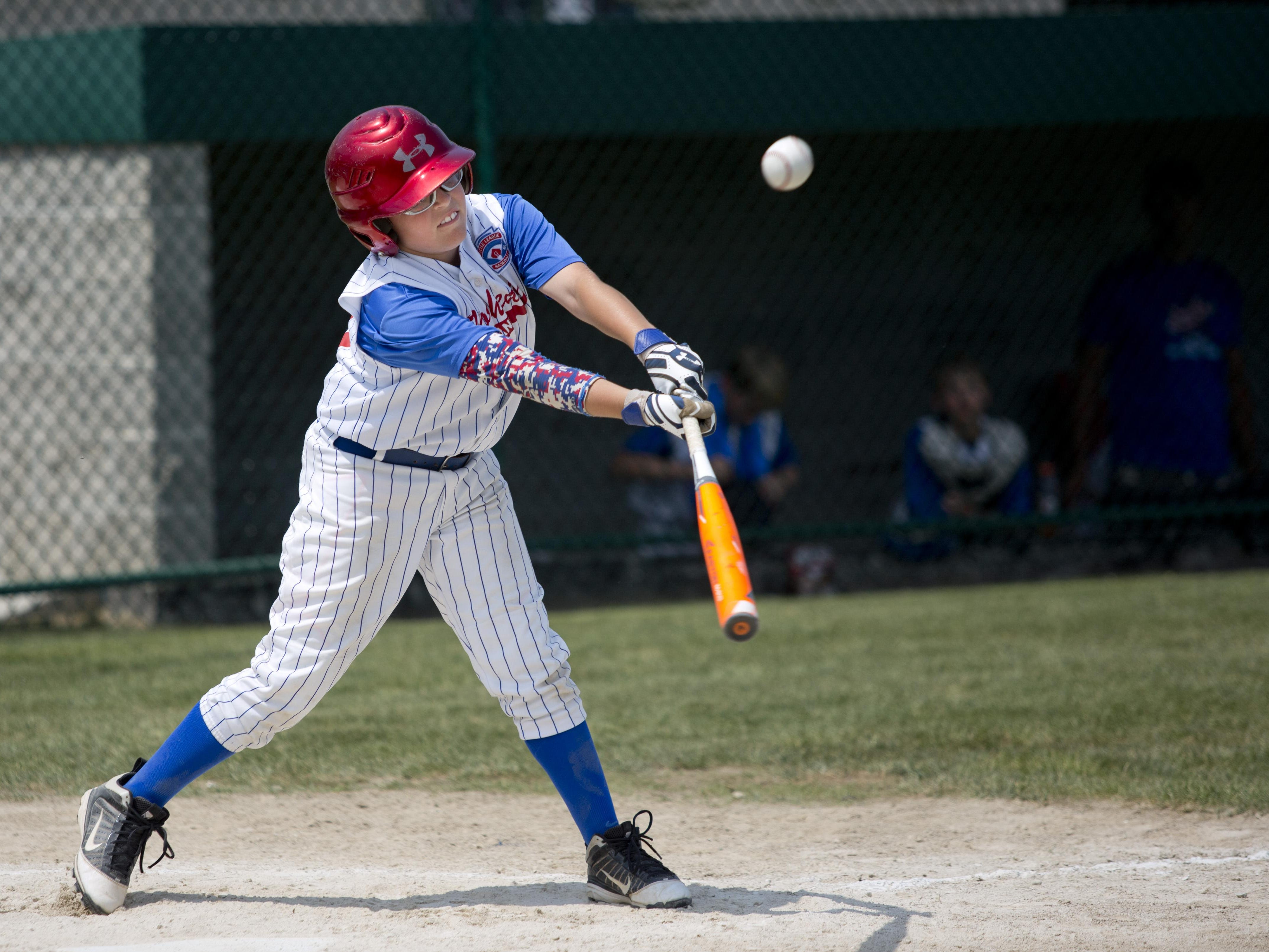 Midland Northeast's Braylen Laverty gets a hit during a state final 10-and-under baseball game Wednesday, July 29, 2015 in St. Clair.