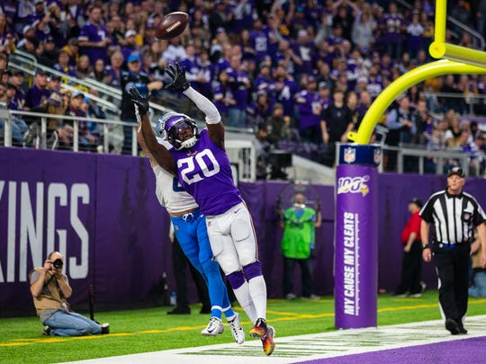Dec 8, 2019; Minneapolis, MN, USA; Minnesota Vikings cornerback Mackensie Alexander (20) breaks up a pass intended for Detroit Lions wide receiver Danny Amendola (80) during the fourth quarter at U.S. Bank Stadium. Mandatory Credit: Harrison Barden-USA TODAY Sports