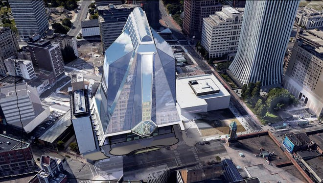 A proposed 25-story glass tower to include a performing arts center, offices and condos is a late-arriving concept in discussions of Midtown's Parcel 5.
