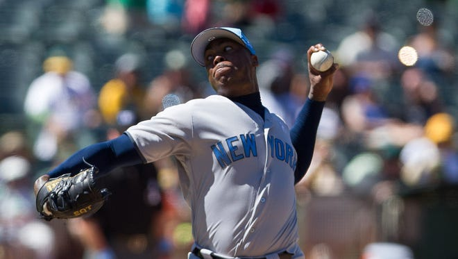 Yankees relief pitcher Aroldis Chapman throws a pitch against the Athletics in the eighth inning at Oakland Coliseum.
