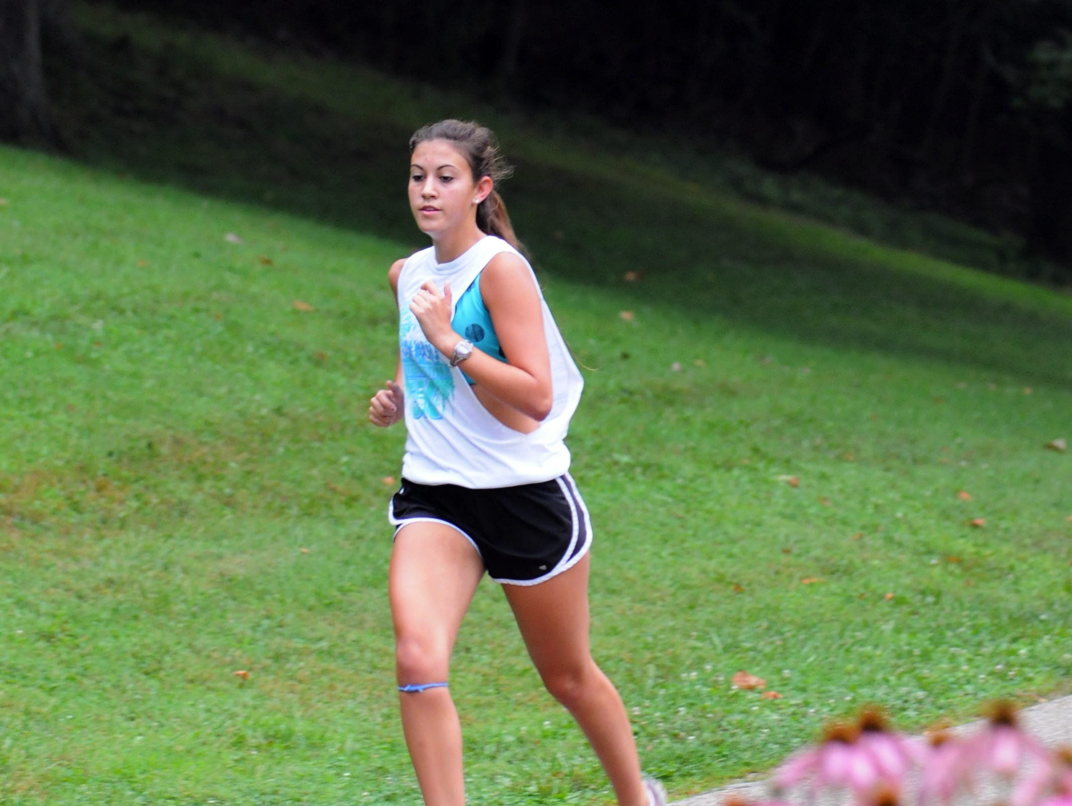 Lancaster senior Savannah McCray runs during the Golden Gales practice Aug. 12 at Rising Park in Lancaster.